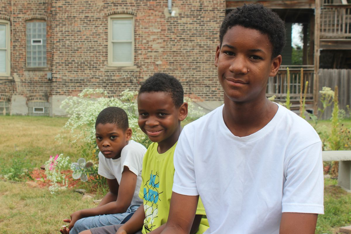 Fuller Elementary School students (from left)Tyrese Robinson-Guy, Terrell Johnson, and Jasean Waters at a community garden in Bronzeville.