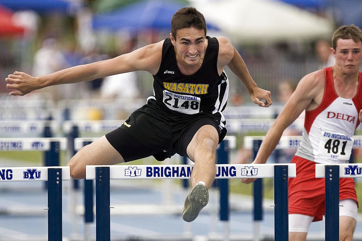 Cale Strong of Wasatch wins the 100m hurdles event at the BYU High School Invitational Track Meet on the Clarence Robison Track at BYU in Provo on Saturday, May 7, 2011.
