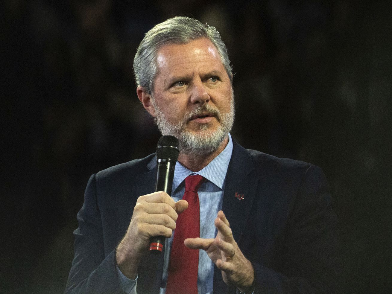"""In this, Nov. 13 2019, file photo, Liberty University President Jerry Falwell Jr. talks to Donald Trump Jr. about his new book """"Triggered"""" during convocation at Liberty University in Lynchburg, Va."""
