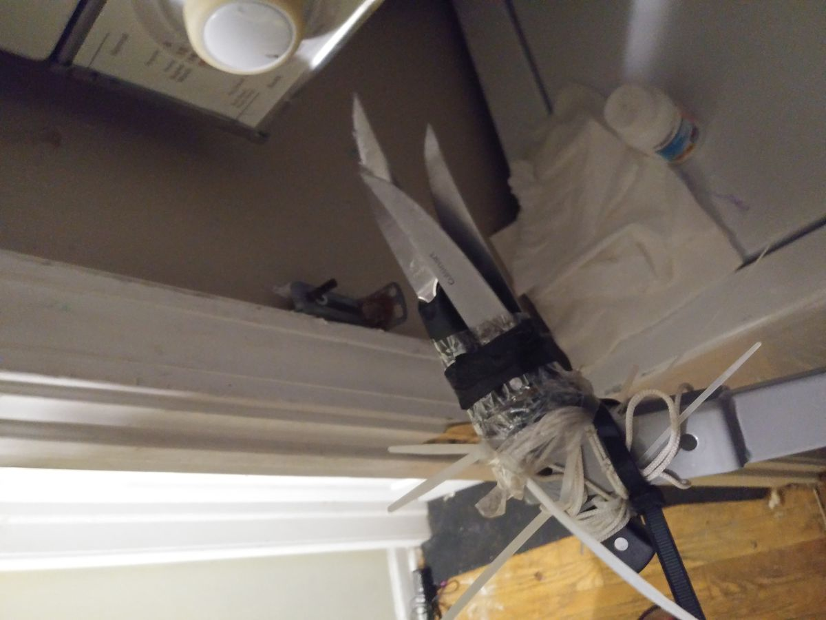 One of several homemade weapons found in the apartment occupied by the squatter. Three knives are attached to a pole.