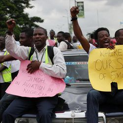"""Former Air Nigeria staff protest after they were fired in Lagos, Nigeria, Friday, Sept. 7, 2012. More than 60 workers from Air Nigeria protested Friday at Lagos' Murtala Muhammed International Airport's domestic terminal, demanding four-months-worth of unpaid salaries from the company. The airline's owner, business tycoon Jimoh Ibrahim, fired nearly all of the company's 800 employees for """"disloyalty"""" earlier this month."""