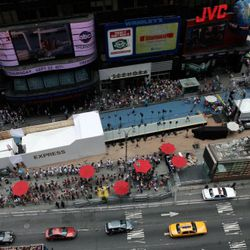 <em>Image via Getty</em><br /><br />Although the heat kept many others away from Times Square, 1,243 Express fans stuck it out for the opportunity to walk the runway.