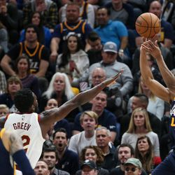 Utah Jazz guard Donovan Mitchell (45) puts a shot over Cleveland Cavaliers forward Jeff Green (32) at Vivint Arena in Salt Lake City on Saturday, Dec. 30, 2017.