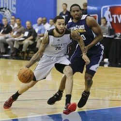 Houston Rockets' Tyler Honeycutt,left, drives to the basket past Utah Jazz's Dionte Christmas, right, during an NBA summer league basketball game, Tuesday, July 9, 2013, in Orlando, Fla. (AP Photo/John Raoux)