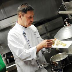 Chef Arun Sampanthavitat preparing dumplings for his summer salad recipe.    Victor Hilitski/For the Sun-Times
