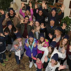 Hands for Cosmas volunteers raising their hands in the air to show support for Opedmoth Cosmus, a 23-year-old Ugandan man whose hands were mangled in an accident. The volunteers are trying to raise nearly $30,000 to fly Cosmas to Salt Lake City to be fitted with prosthetic hands.