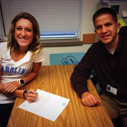 Herriman's Lucy Biles and her coach James Barnes celebrate her signing on Wednesday afternoon.