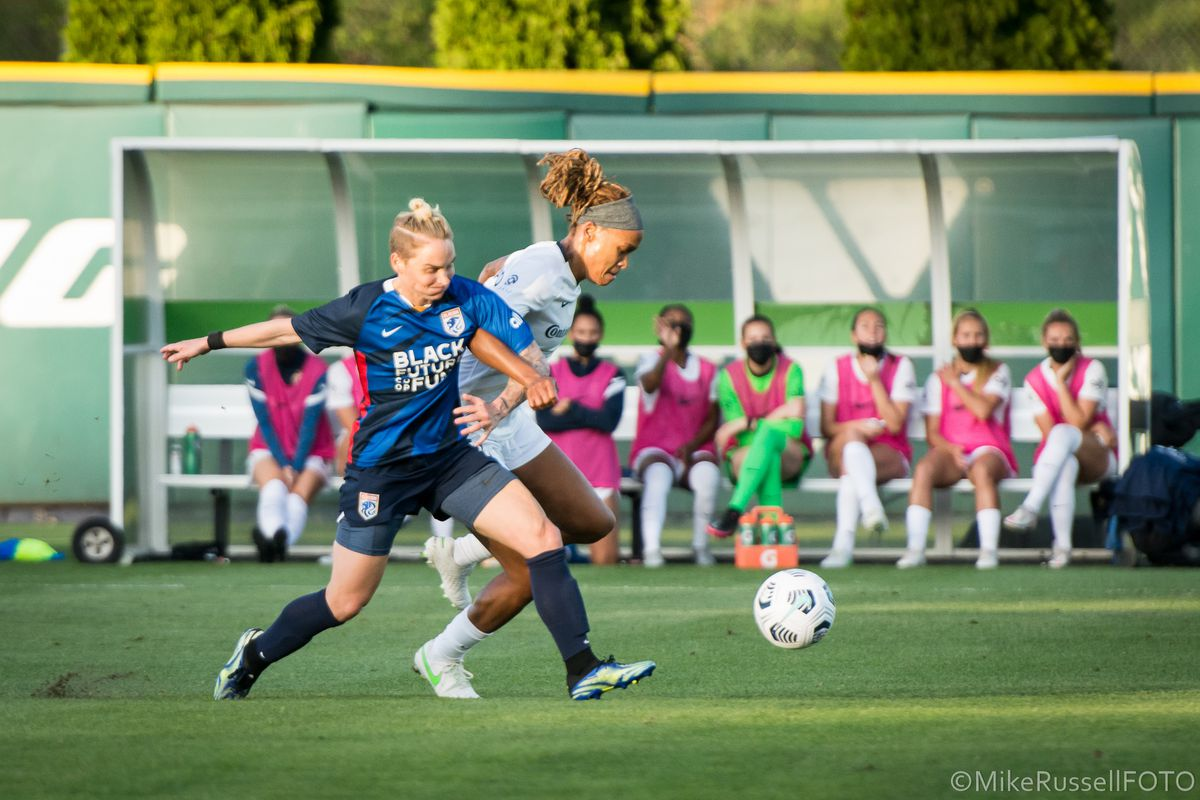 Jess Fishlock and Jess McDonald battle for the ball