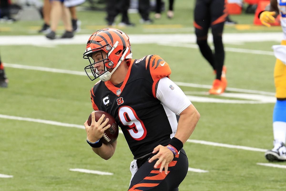Joe Burrow of the Cincinnati Bengals runs for his first NFL touchdown against the Los Angeles Chargers during the game at Paul Brown Stadium on September 13, 2020 in Cincinnati, Ohio.