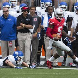 Ohio State Buckeyes quarterback Braxton Miller (5) evades a tackle attempted by Buffalo Bulls linebacker Blake Bean (33) at Ohio Stadium. Ohio State won the game 40-20.