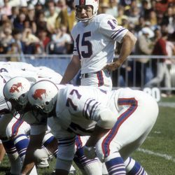 Jack Kemp #15 of the Buffalo Bills stands over center against the Oakland Raiders during an AFL football game at the Oakland-Alameda County Coliseum October 19, 1969 in Oakland, California.