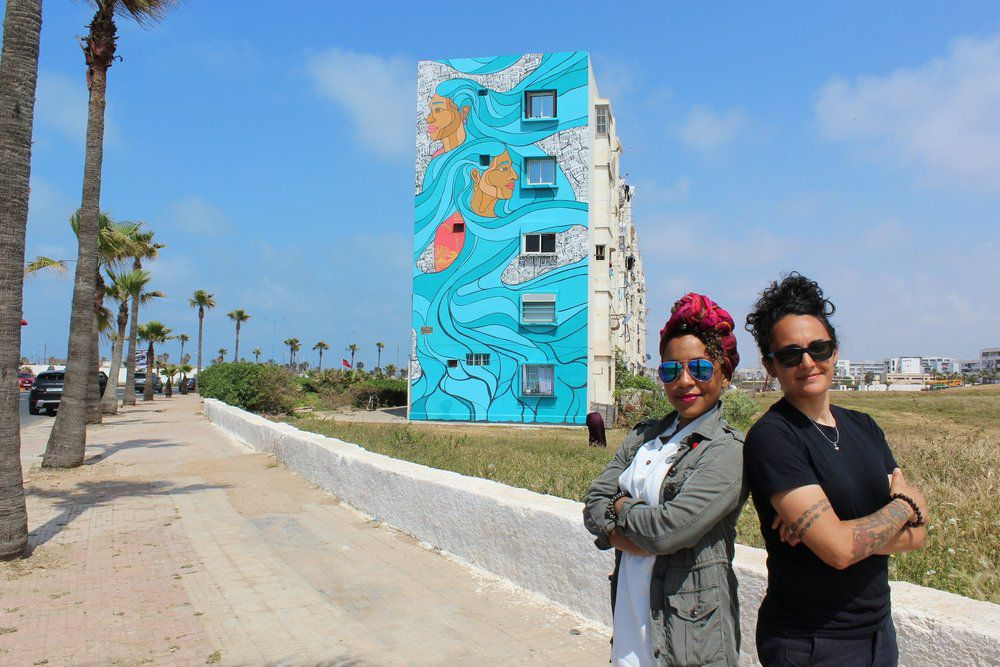 """Jenny Q (left) and Sam Kirk in front of the """"Sister Cities"""" mural last year in Casablanca, Morocco."""
