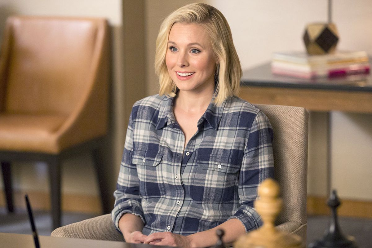 Eleanor (Kristen Bell) sits in Michael's office in a screenshot from The Good Place.