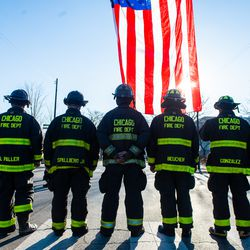Chicago Fire Fighters stand at attention outside the Cook County Medical Examiners Office in perpetration for a procession for a off duty Chicago Police Officer who was fatally shot inside his car in the River North neighborhood, Saturday, March 23, 2019, in Chicago.   Tyler LaRiviere/Sun-Times