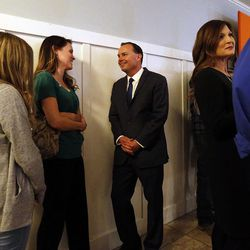 Sen. Mike Lee, R-Utah, greets Maddie Rees, left, and her mother, Jenney, in South Jordan on Tuesday, Nov. 8, 2016, at an election night party. At right is Lee's wife, Sharon.