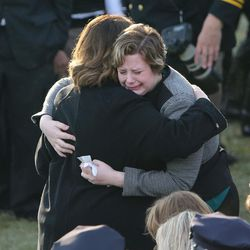 Erika Barney, left, hugs her daughter, Matti, at the gravesite of their husband and father, Unified police officer Doug Barney, at the Orem City Cemetery on Monday, Jan. 25, 2016. Barney was killed in the line of duty on Jan. 17, 2016.