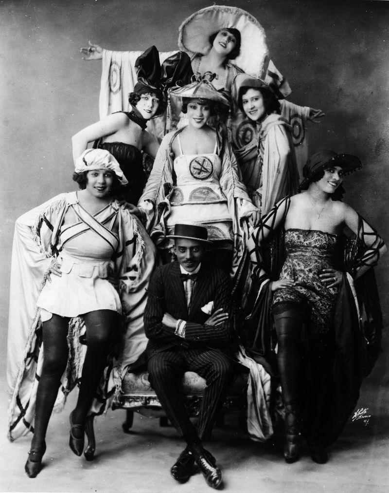 """Noble Sissle with the show's chorines in a publicity photo for the 1921 production of """"Shuffle Along."""""""