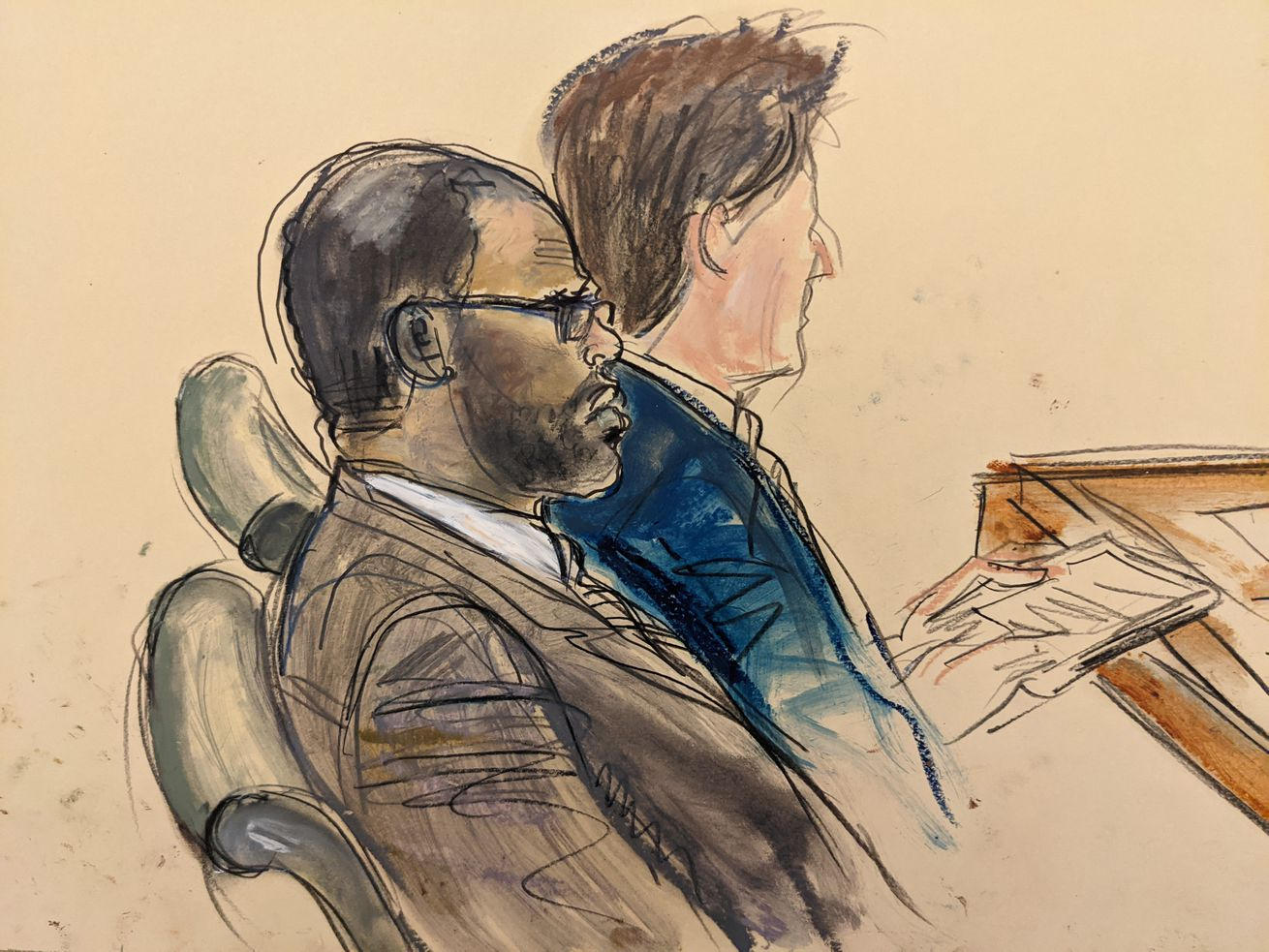 """In this courtroom artist's sketch made from a video screen monitor of a Brooklyn courtroom, defendant R. Kelly, left, listens during the opening day of his trial, Wednesday, Aug. 18, 2021 in New York. The prosecutor described sex abuse claims against Kelly, saying the long-anticipated trial now underway was """"about a predator"""" who used his fame to entice girls, boys and young women before dominating and controlling them physically, sexually and psychologically."""