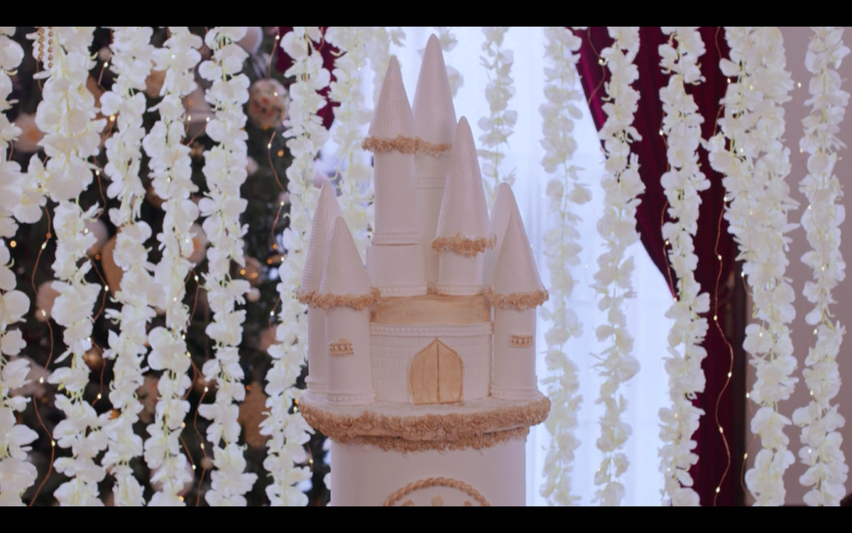 Close-up of a cake topper made to look like a castle