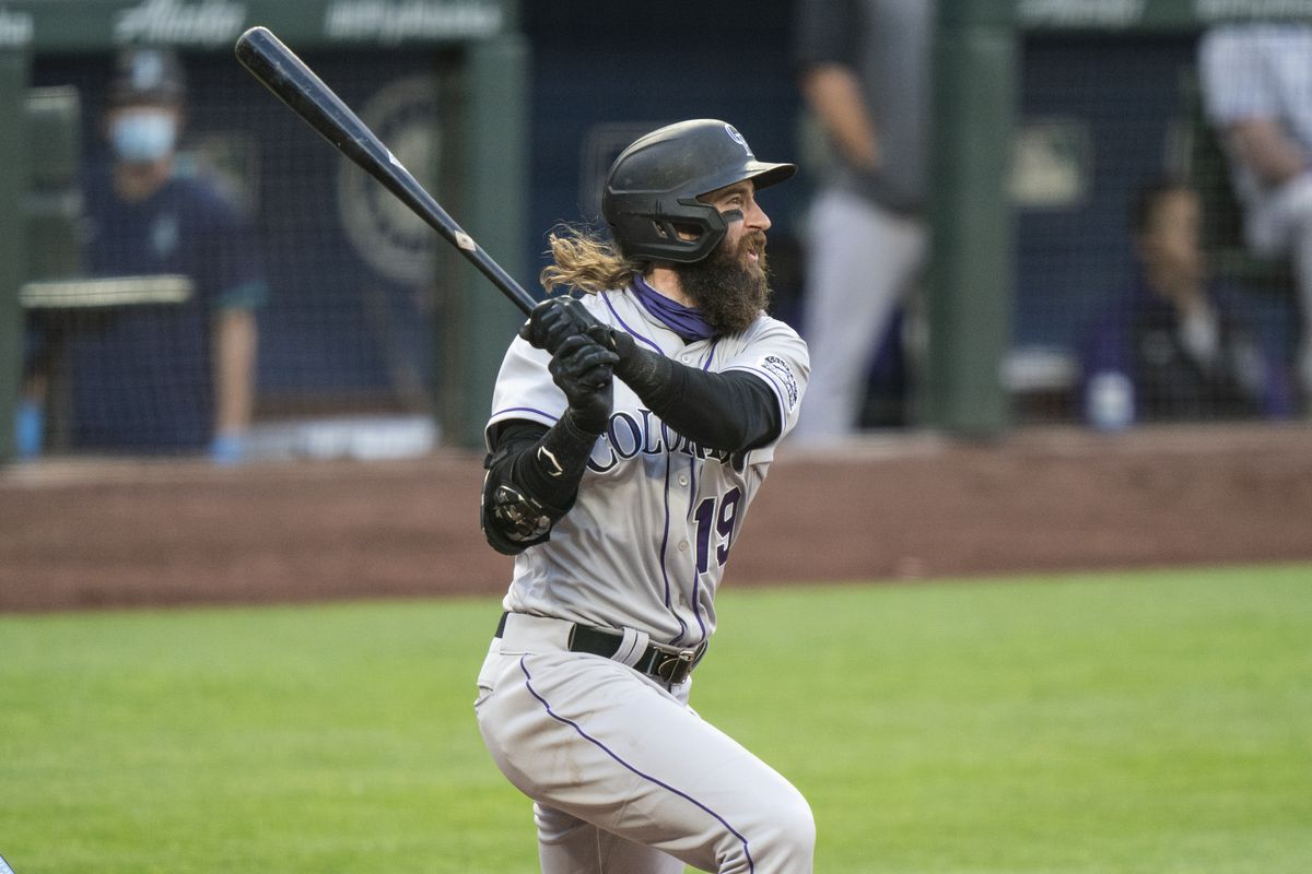 Charlie Blackmon #19 of the Colorado Rockies hits a three-run double off of relief pitcher Joey Gerber #59 of the Seattle Mariners that scored Garrett Hampson #1 of the Colorado Rockies, Trevor Story #27 and Ryan McMahon #24 during the fifth inning of a game at T-Mobile Park on August, 8, 2020 in Seattle, Washington.