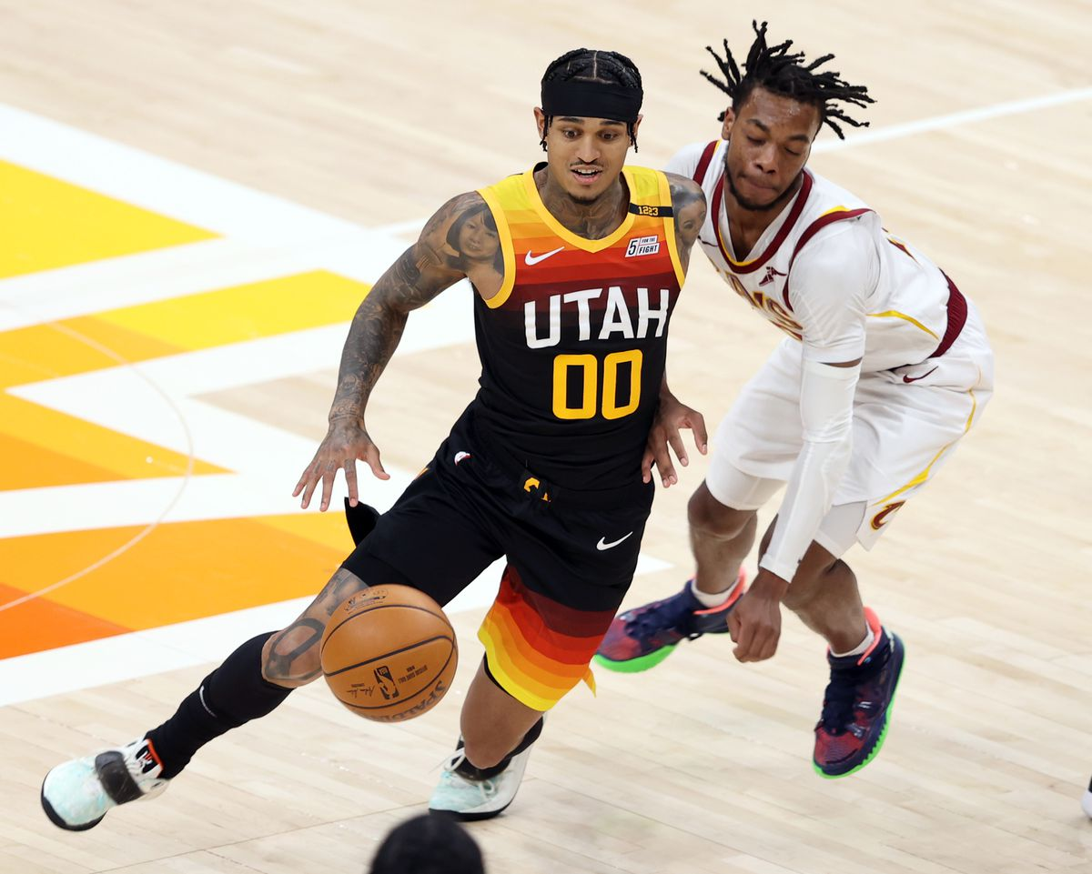 Utah Jazz guard Jordan Clarkson (00) drives around Cleveland Cavaliers guard Darius Garland (10) as the Utah Jazz and the Cleveland Cavaliers play an NBA basketball game at Vivint Smart Home Arena in Salt Lake City on Monday, March 29, 2021. Utah won 114-75.