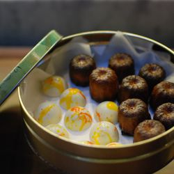 Petit fours will be served table side from vintage cookie tins