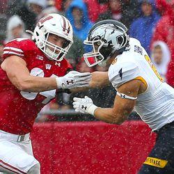 Mason Stokke (#34) blocking in the rain.