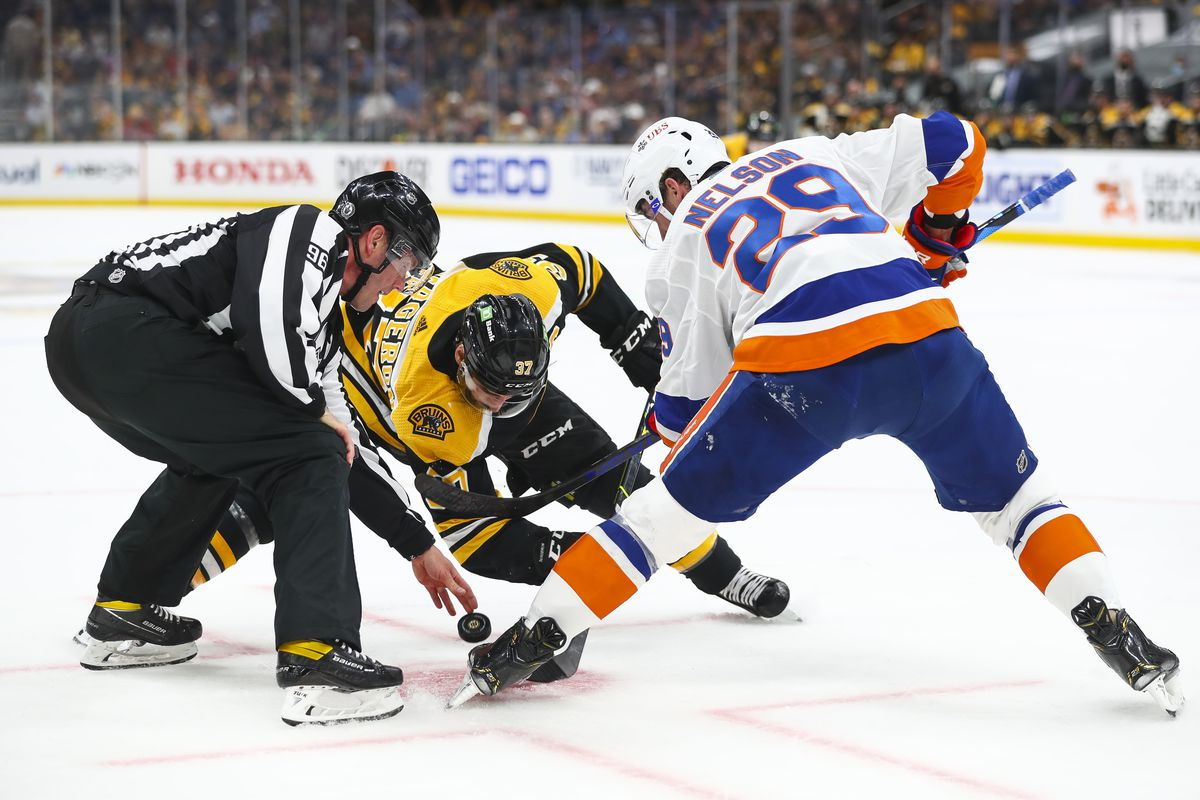 Linesman David Brisebois initiates a face-off between Patrice Bergeron #37 of the Boston Bruins and Brock Nelson #29 of the New York Islanders in Game Five of the Second Round of the 2021 Stanley Cup Playoffs at TD Garden on June 7, 2021 in Boston, Massachusetts.