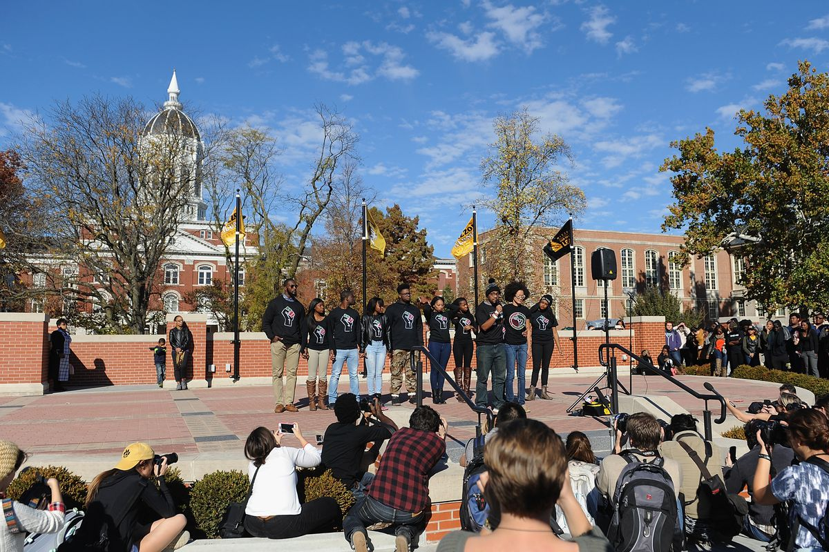 Members of the Concerned Student 1950 movement speak to students after president Tim Wolfe announced his resignation.