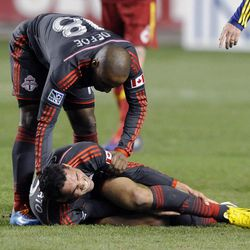 Toronto FC forward Gilberto Oliveira Souza Junior (9) grabs his ankle during a game at Rio Tinto Stadium in Sandy on Saturday, March 29, 2014.
