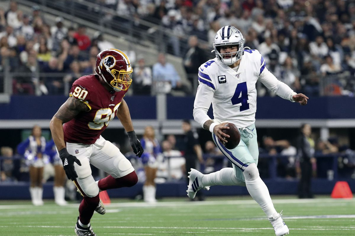 Dallas Cowboys quarterback Dak Prescott looks to throw past Washington linebacker Montez Sweat during the first quarter at AT&T Stadium.