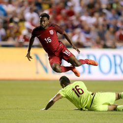 United States' Kellyn Acosta (16) jumps over Venezuela's Aristoteles Romero (16) during a soccer game at Rio Tinto Stadium in Sandy on Saturday, June 3, 2017. They tied 1-1.