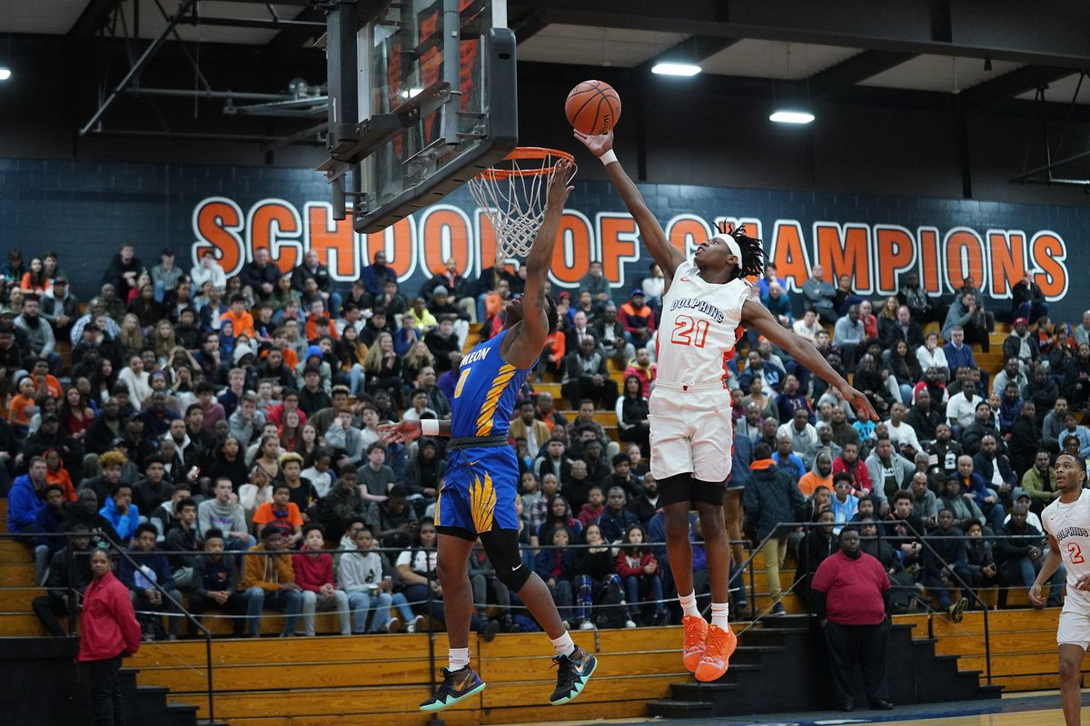 Simeon's Kejuan Clements (0) gets his shoot blocked by Young's DJ Steward (21),