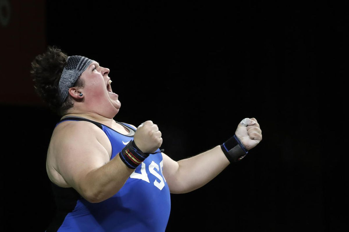 Sarah Elizabeth Robles, of the United States, celebrates after a lift during the women's 75kg weightlifting competition at the 2016 Summer Olympics in Rio de Janeiro, Brazil, Sunday, Aug. 14, 2016. (AP Photo/Mike Groll)