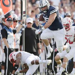 Brigham Young Cougars tight end Nate Sampson (85) jumps over Southern Utah Thunderbirds cornerback Josh Thornton (2) on a catch and run  in Provo on Saturday, Nov. 12, 2016.