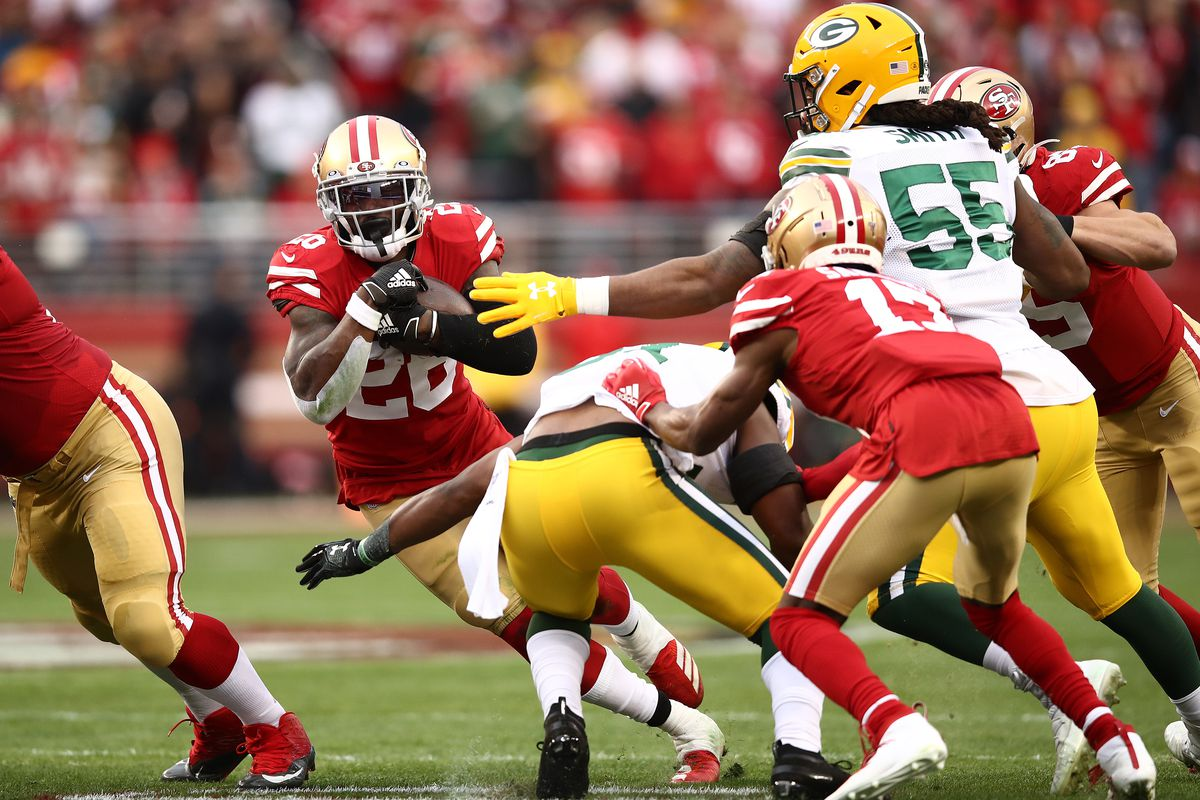 Tevin Coleman of the San Francisco 49ers rushes with the ball against the Green Bay Packers during the NFC Championship game at Levi's Stadium on January 19, 2020 in Santa Clara, California.