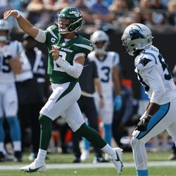 New York Jets quarterback Zach Wilson watches his first NFL touchdown pass during the second half of an NFL football game against the Carolina Panthers Sunday, Sept. 12, 2021, in Charlotte, N.C.