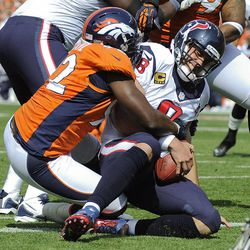 Houston Texans quarterback Matt Schaub (8) is sacked in the end zone for a safety by Denver Broncos defensive end Elvis Dumervil (92) during the first quarter of an NFL football game Sunday, Sept. 23, 2012, in Denver.