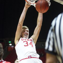 Utah center Jayce Johnson dunks the ball during the team's season-opening showcase, Night with the Runnin' Utes, at the Huntsman Center in Salt Lake City on Tuesday, Oct. 18, 2016.