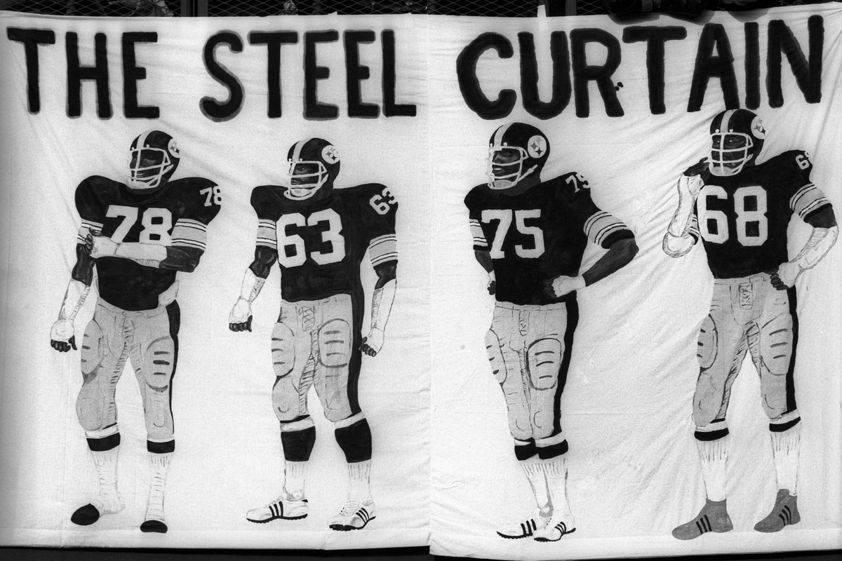 The Steel Curtain defense of the Pittsburgh Steelers is memorialized by an artist on a bed sheet during the playoff game between the Pittsburgh Steelers and Buffalo Bills.