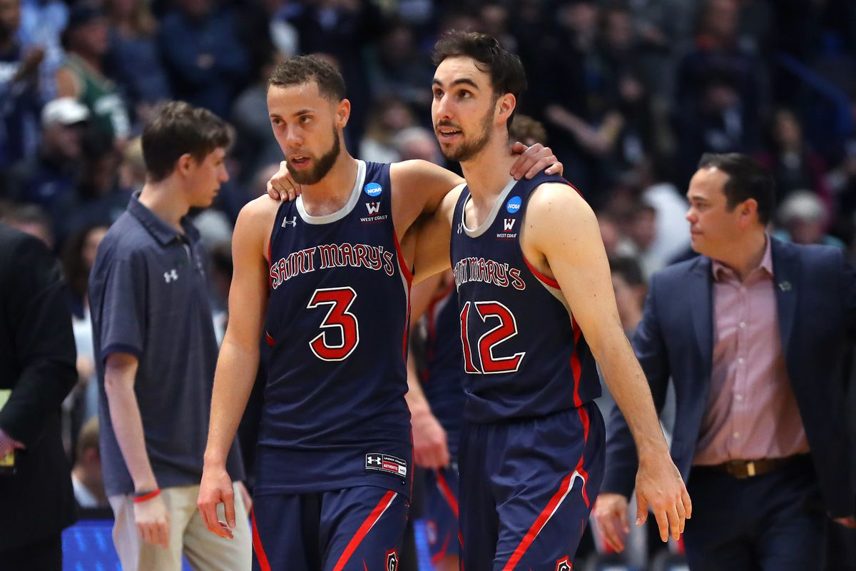Jordan Ford and Tommy Kuhse of the Saint Mary's Gaels walk off the court after being defeated by the Villanova Wildcats during the first round of the 2019 NCAA Men's Basketball Tournament at XL Center on March 21, 2019 in Hartford, Connecticut.
