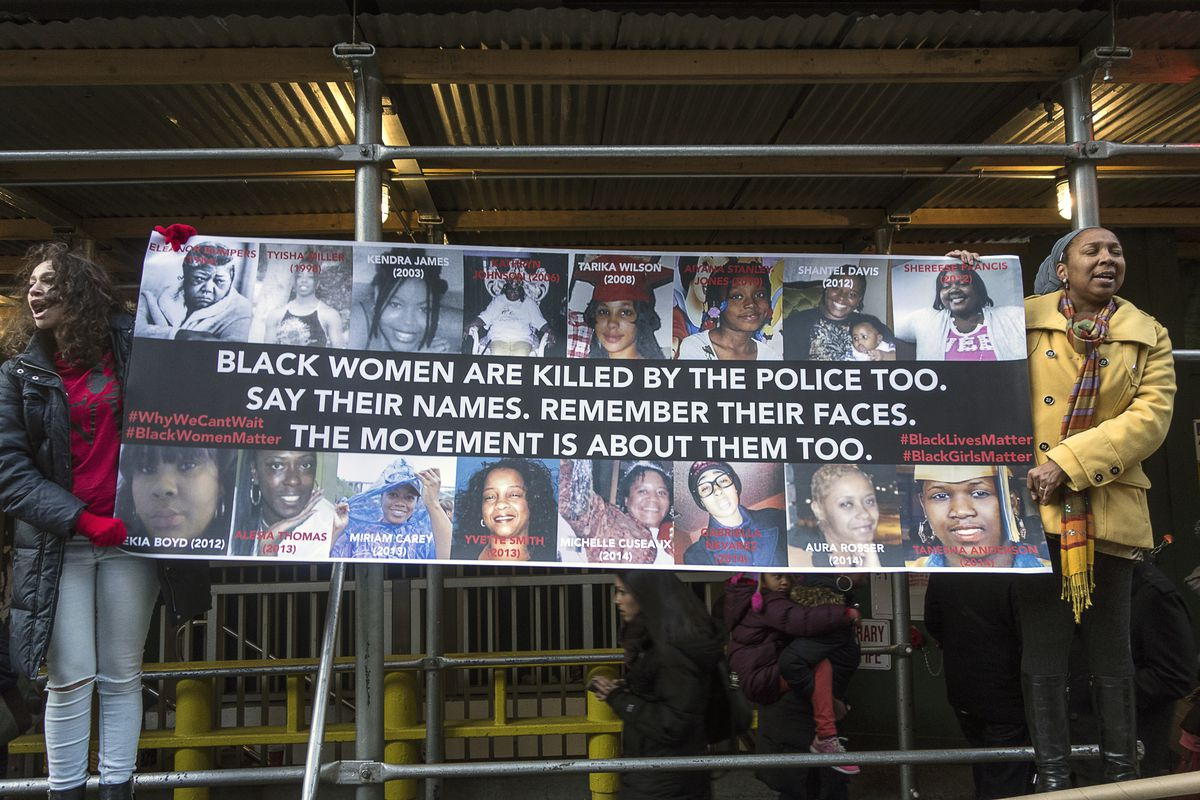 Protesters hold up a sign listing black women killed by police on December 13, 2014.