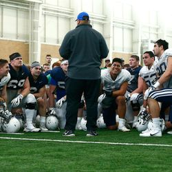 BYU coach Kalani Sitake talks to the team following the Cougars' practice in the Indoor Practice Facility on Thursday, March 15, 2018 in Provo.