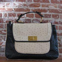 Beautiful black-and-white Covet satchel
