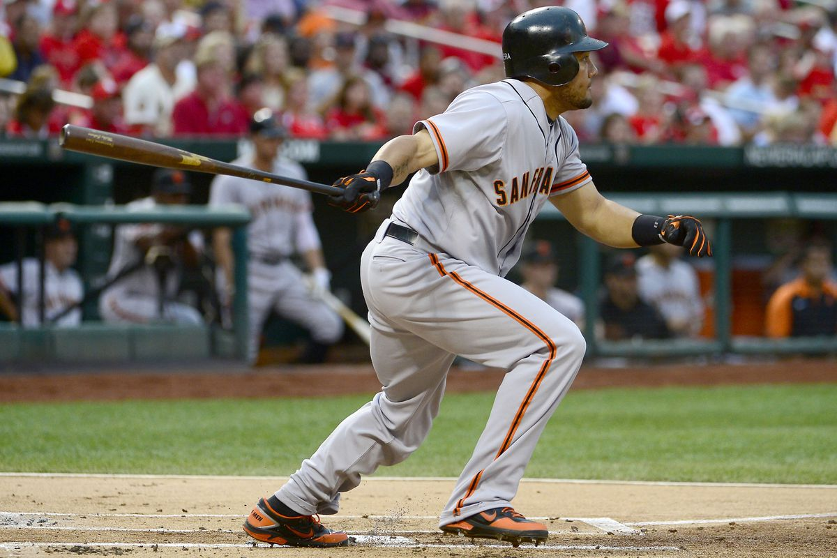 Aug 8, 2012; St. Louis, MO, USA; San Francisco Giants left fielder Melky Cabrera watches his huge payday fly out of the park as he prepares to play for the Dodgers one day.