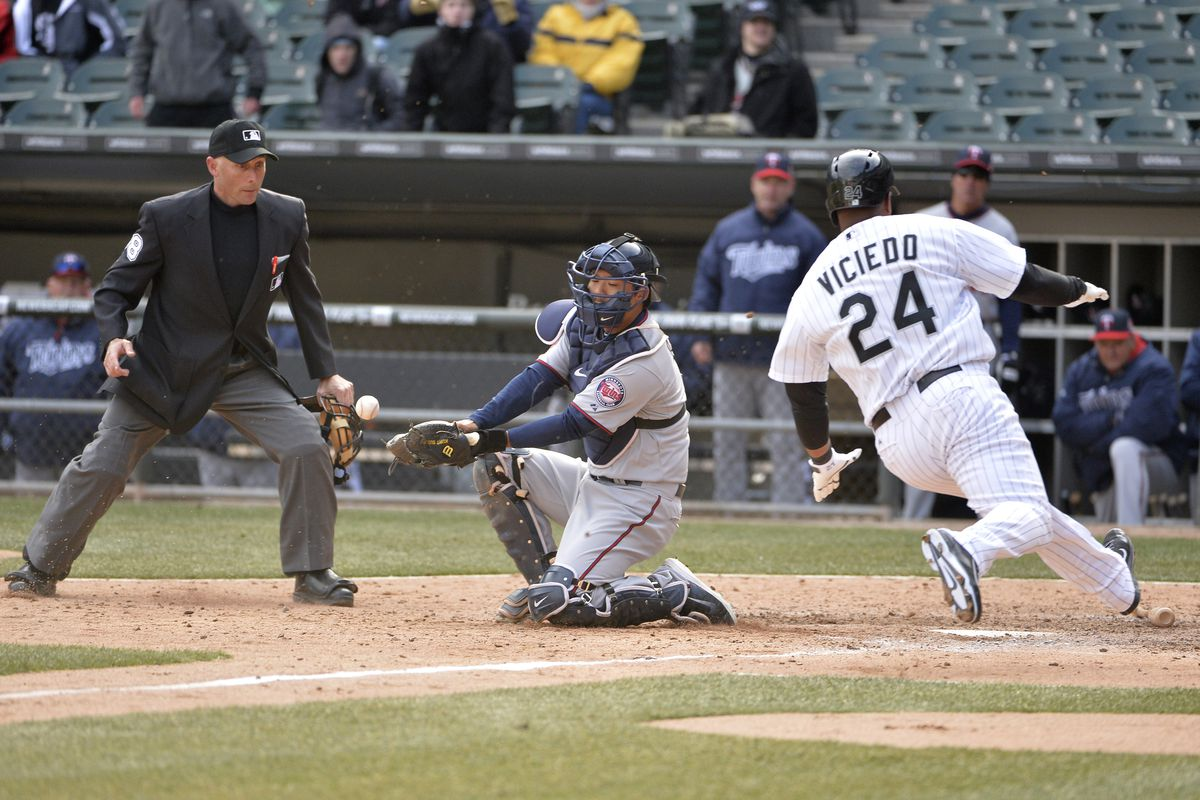 A wild throw by Trevor Plouffe in the 9th inning allowed the White Sox to score the tying run.
