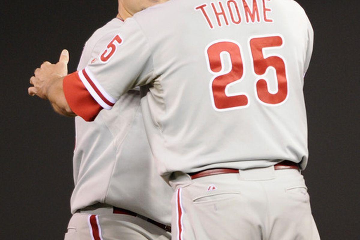 """Nice pitching, Big Joe."" Thanks, Big Jim."". (Photo by Hannah Foslien/Getty Images)"