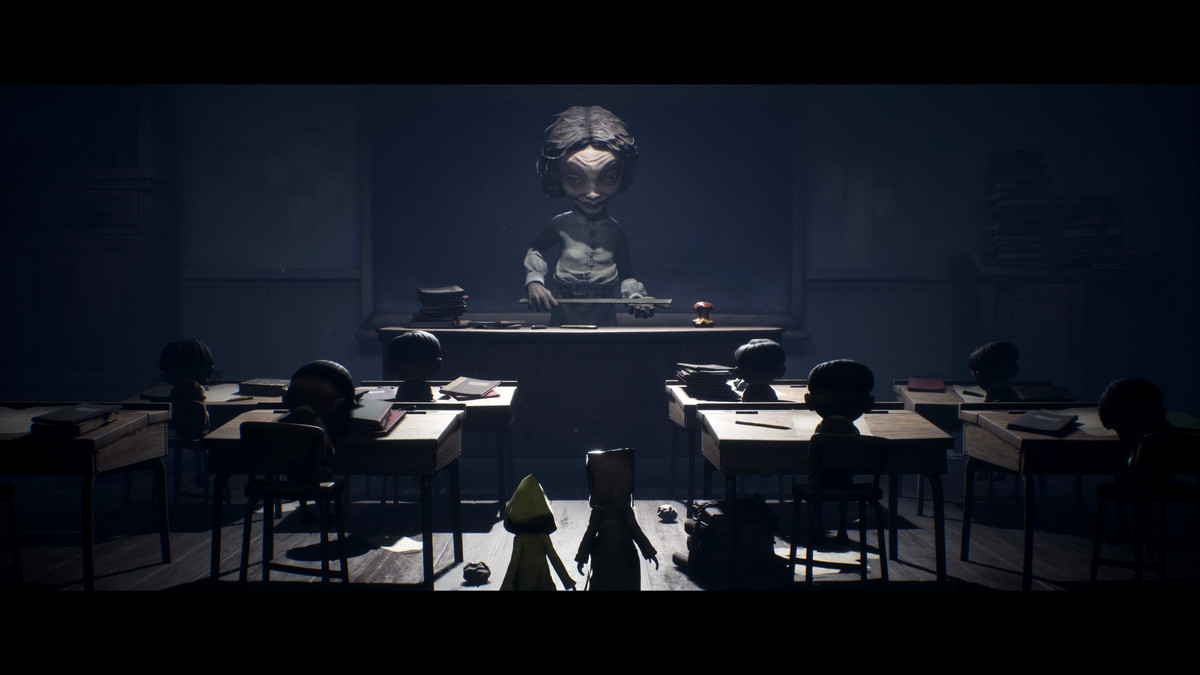 Mono and Six stand in front of the monstrous school teacher in Little Nightmares 2