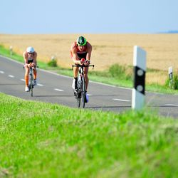 Participants compete during the bike leg of Challenge Roth on July 20, 2014 in Roth, Germany. (Photo by Lennart Preiss/Getty Images)