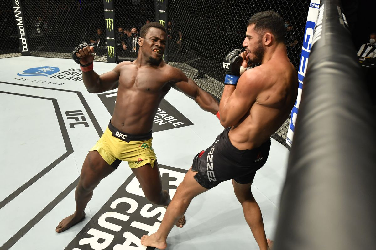 Abdul Razak Alhassan of Ghana punches Mounir Lazzez of Tunisia in their welterweight fight during the UFC Fight Night event inside Flash Forum on UFC Fight Island on July 16, 2020 in Yas Island, Abu Dhabi, United Arab Emirates.